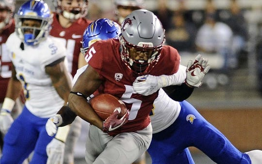 Sep 8, 2018; Pullman, WA, USA; Washington State Cougars wide receiver Travell Harris (5) is tackled after a catch by theSan Jose State Spartans during the first half at Martin Stadium. Mandatory Credit: James Snook-USA TODAY Sports