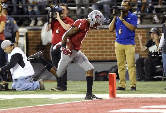 Sep 8, 2018; Pullman, WA, USA; Washington State Cougars wide receiver Davontavean Martin (1) runs the ball in for a touchdown against the San Jose State Spartans during the first half at Martin Stadium. Mandatory Credit: James Snook-USA TODAY Sports