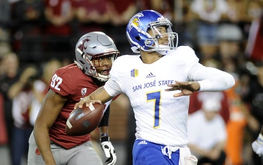 Sep 8, 2018; Pullman, WA, USA; Washington State Cougars defensive end Will Rodgers III (92) chase San Jose State Spartans quarterback Montel Aaron (7) out of the pocket during the first half at Martin Stadium. Mandatory Credit: James Snook-USA TODAY Sports