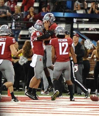 Sep 8, 2018; Pullman, WA, USA; Washington State Cougars wide receiver Jamire Calvin (6) celebrates a touchdown with quarterback Gardner Minshew (16) against the San Jose State Spartans during the first half at Martin Stadium. Mandatory Credit: James Snook-USA TODAY Sports