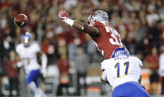 Sep 8, 2018; Pullman, WA, USA; Washington State Cougars running back James Williams (32) is unable to hold onto the ball after the hit by San Jose State Spartans linebacker Jesse Osuna (11) during the first half at Martin Stadium. Mandatory Credit: James Snook-USA TODAY Sports