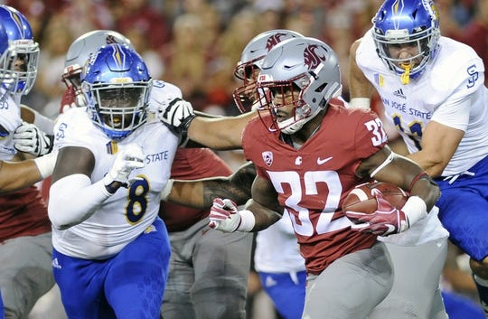 Sep 8, 2018; Pullman, WA, USA; Washington State Cougars running back James Williams (32) tries to run the ball on the edge against San Jose State Spartans defensive tackle Boogie Roberts (8) during the first half at Martin Stadium. Mandatory Credit: James Snook-USA TODAY Sports