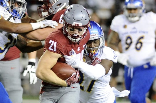 Sep 8, 2018; Pullman, WA, USA; Washington State Cougars running back Max Borghi (21) is caught from behind by San Jose State Spartans safety Jonathan Lenard Jr. (27) during the first half at Martin Stadium. Mandatory Credit: James Snook-USA TODAY Sports