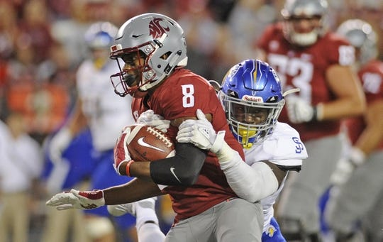Sep 8, 2018; Pullman, WA, USA; Washington State Cougars wide receiver Easop Winston (8) is tackled by San Jose State Spartans linebacker Jamal Scott (5) during the first half at Martin Stadium. Mandatory Credit: James Snook-USA TODAY Sports