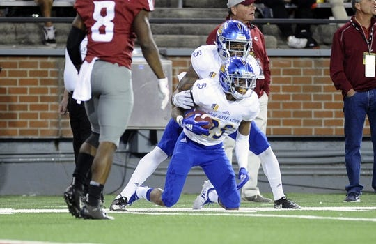 Sep 8, 2018; Pullman, WA, USA; San Jose State Spartans cornerback Nehemiah Shelton (23) comes up with a interception against the Washington State Cougars during the first half at Martin Stadium. Mandatory Credit: James Snook-USA TODAY Sports