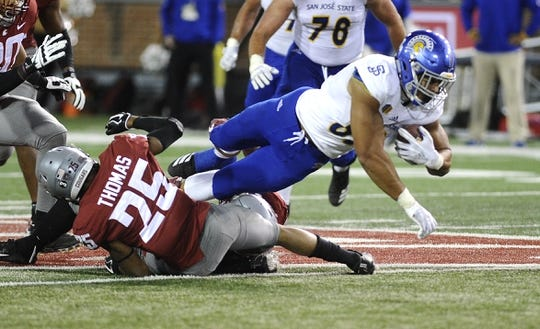 Sep 8, 2018; Pullman, WA, USA; San Jose State Spartans tight end Josh Oliver (89) is tackled by Washington State Cougars safety Skyler Thomas (25) during the second half at Martin Stadium. Mandatory Credit: James Snook-USA TODAY Sports