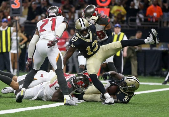 Sep 9, 2018; New Orleans, LA, USA; New Orleans Saints running back Alvin Kamara (41) scores a touchdown in the first quarter against the Tampa Bay Buccaneers at the Mercedes-Benz Superdome. Mandatory Credit: Chuck Cook-USA TODAY Sports