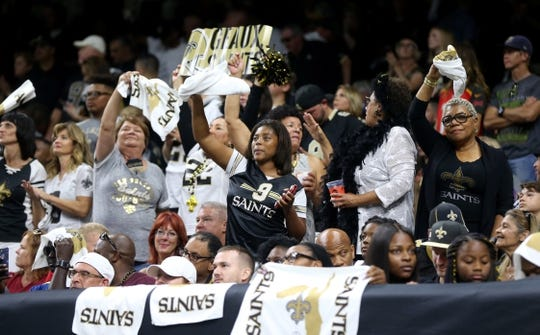 Sep 9, 2018; New Orleans, LA, USA; New Orleans Saints fans celebrate a score in the first quarter against the Tampa Bay Buccaneers at the Mercedes-Benz Superdome. Mandatory Credit: Chuck Cook-USA TODAY Sports