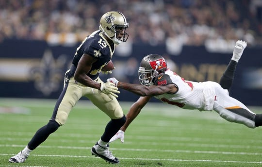 Sep 9, 2018; New Orleans, LA, USA; New Orleans Saints wide receiver Michael Thomas (13) eludes Tampa Bay Buccaneers cornerback Carlton Davis (33) in the first quarter at the Mercedes-Benz Superdome. Mandatory Credit: Chuck Cook-USA TODAY Sports