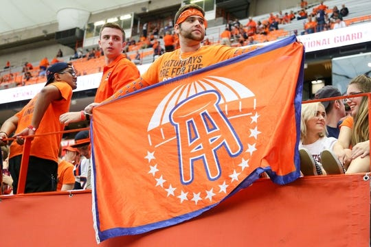 Sep 8, 2018; Syracuse, NY, USA; A Syracuse Orange fan holds a flag with the Barstool Sports logo prior to the game against the Wagner Seahawks at the Carrier Dome. Mandatory Credit: Rich Barnes-USA TODAY Sports
