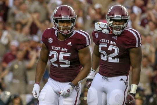 Sep 8, 2018; College Station, TX, USA; Texas A&M Aggies defensive lineman Justin Madubuike (52) and linebacker Tyrel Dodson (25) during the game against the Clemson Tigers at Kyle Field. Mandatory Credit: John Glaser-USA TODAY Sports