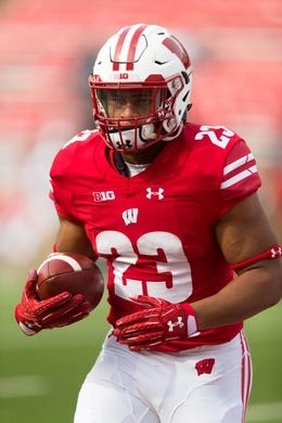 Sep 8, 2018; Madison, WI, USA; Wisconsin Badgers running back Jonathan Taylor (23) during warmups prior to the game against the New Mexico Lobos at Camp Randall Stadium. Mandatory Credit: Jeff Hanisch-USA TODAY Sports