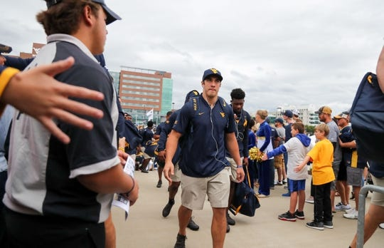 Sep 8, 2018; Morgantown, WV, USA; West Virginia Mountaineers linebacker Dylan Tonkery (10) arrives at the stadium before their game against the Youngstown State Penguins at Mountaineer Field at Milan Puskar Stadium. Mandatory Credit: Ben Queen-USA TODAY Sports