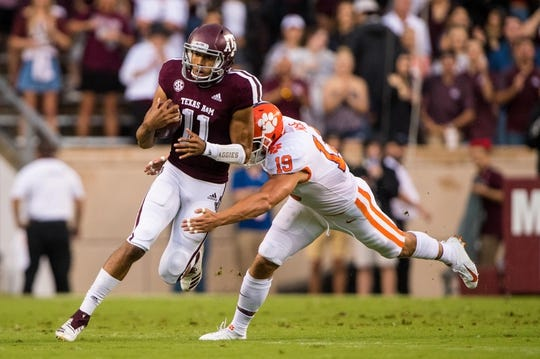Sep 8, 2018; College Station, TX, USA; Texas A&M Aggies quarterback Kellen Mond (11) and Clemson Tigers safety Tanner Muse (19) in action during the game at Kyle Field. Mandatory Credit: Jerome Miron-USA TODAY Sports