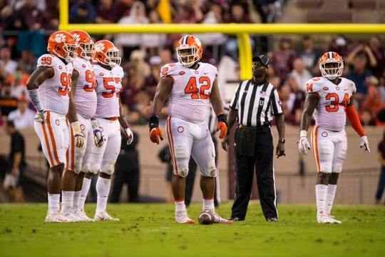 Sep 8, 2018; College Station, TX, USA; Clemson Tigers defensive end Clelin Ferrell (99) and defensive tackle Dexter Lawrence (90) and linebacker Tre Lamar (57) and defensive lineman Christian Wilkins (42) and linebacker Kendall Joseph (34) in action during the game against the Texas A&M Aggies at Kyle Field. Mandatory Credit: Jerome Miron-USA TODAY Sports