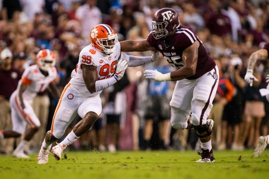 Sep 8, 2018; College Station, TX, USA; Clemson Tigers defensive end Clelin Ferrell (99) and Texas A&M Aggies offensive lineman Dan Moore Jr. (65) in action during the game at Kyle Field. Mandatory Credit: Jerome Miron-USA TODAY Sports