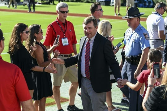 Sep 15, 2018; Athens, GA, USA; Georgia Bulldogs head coach Kirby Smart walks through the line during Dawg Walk prior to the game against the Middle Tennessee Blue Raiders at Sanford Stadium. Mandatory Credit: Dale Zanine-USA TODAY Sports