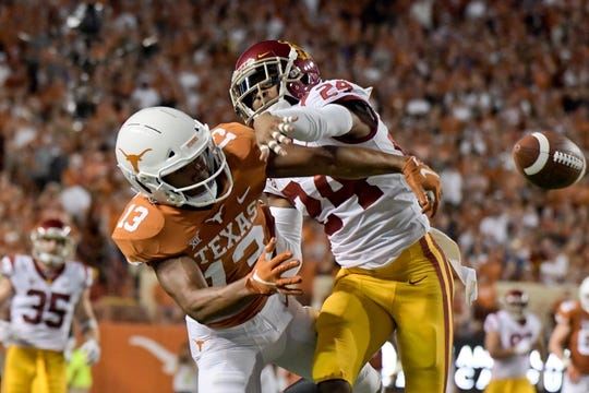 Sep 15, 2018; Austin, TX, USA; Southern California Trojans cornerback Isaiah Langley (24) breaks up a pass intended for Texas Longhorns wide receiver Jerrod Heard (13) during the first half at Darrell K Royal-Texas Memorial Stadium. Mandatory Credit: Kirby Lee-USA TODAY Sports