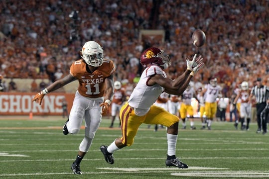 Sep 15, 2018; Austin, TX, USA; Southern California Trojans wide receiver Velus Jones Jr. (1) catches a pass against Texas Longhorns defensive back P.J. Locke III (11) during the first half at Darrell K Royal-Texas Memorial Stadium. Mandatory Credit: Kirby Lee-USA TODAY Sports