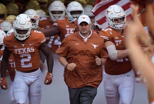 Sep 15, 2018; Austin, TX, USA; Texas Longhorns head coach Tom Herman runs onto the field during the game against the Southern California Trojans at Darrell K Royal-Texas Memorial Stadium. Mandatory Credit: Kirby Lee-USA TODAY Sports