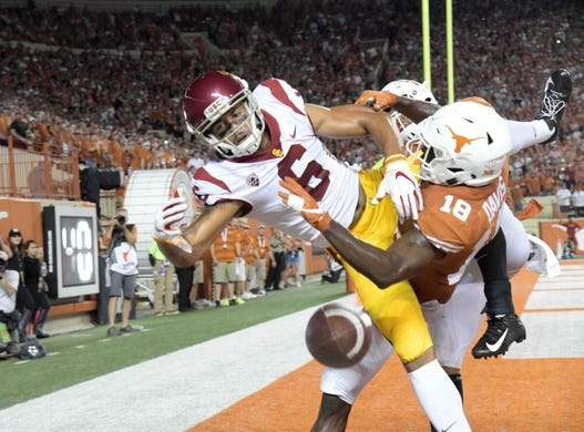 Sep 15, 2018; Austin, TX, USA; Southern California Trojans wide receiver Michael Pittman Jr. (6) is defended by Texas Longhorns defensive back Davante Davis (18) in the second quarter at Darrell K Royal-Texas Memorial Stadium. Mandatory Credit: Kirby Lee-USA TODAY Sports