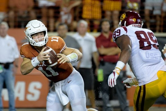 Sep 15, 2018; Austin, TX, USA; Texas Longhorns quarterback Sam Ehlinger (11) scrambles to avoid Southern California Trojans defensive lineman Christian Rector (89) during the first half at Darrell K Royal-Texas Memorial Stadium. Mandatory Credit: Kirby Lee-USA TODAY Sports