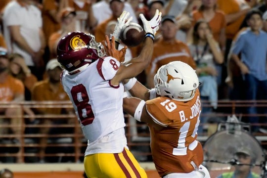 Sep 15, 2018; Austin, TX, USA; Texas Longhorns defensive back Brandon Jones (19) goes for the pass intended for Southern California Trojans wide receiver Amon-Ra St. Brown (8) during the first half at Darrell K Royal-Texas Memorial Stadium. Mandatory Credit: Kirby Lee-USA TODAY Sports