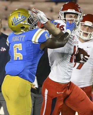 Sep 15, 2018; Pasadena, CA, USA; Fresno State Bulldogs tight end Jared Rice (16) has his face mask grabbed by UCLA Bruins defensive back Adarius Pickett (6) during the first quarter at Rose Bowl. Mandatory Credit: Robert Hanashiro-USA TODAY Sports
