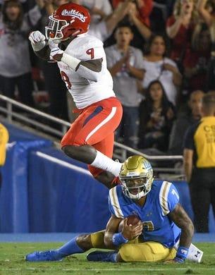 Sep 15, 2018; Pasadena, CA, USA; Fresno State Bulldogs linebacker Jeff Allison (9) celebrates sacking UCLA Bruins quarterback Dorian Thompson-Robinson (7)  during the first quarter at Rose Bowl. The play was called back on a penalty. Mandatory Credit: Robert Hanashiro-USA TODAY Sports
