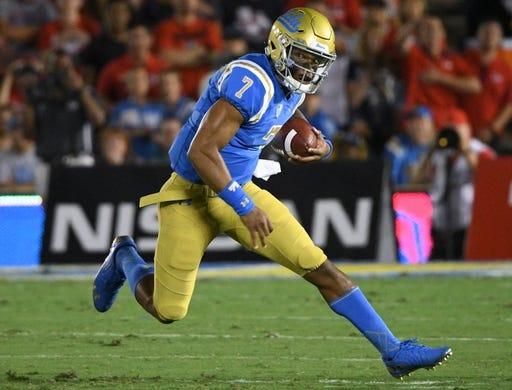 Sep 15, 2018; Pasadena, CA, USA; UCLA Bruins quarterback Dorian Thompson-Robinson (7) scrambles out of the pocket during the first quarter against the Fresno State Bulldogs at Rose Bowl. Mandatory Credit: Robert Hanashiro-USA TODAY Sports