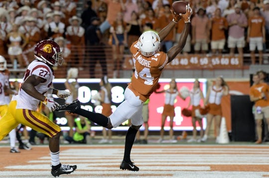 Sep 15, 2018; Austin, TX, USA; Texas Longhorns wide receiver Joshua Moore (14) catches a pass for a touchdown against the Southern California Trojans during the second half at Darrell K Royal-Texas Memorial Stadium. Mandatory Credit: Kirby Lee-USA TODAY Sports