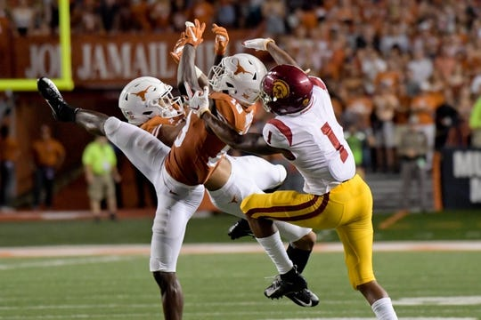 Sep 15, 2018; Austin, TX, USA; Texas Longhorns defensive back Davante Davis (18) breaks up a pass intended for Southern California Trojans wide receiver Velus Jones Jr. (1) during the first half at Darrell K Royal-Texas Memorial Stadium. Mandatory Credit: Kirby Lee-USA TODAY Sports