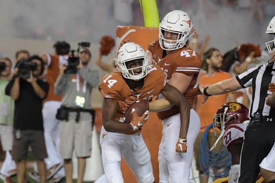 Sep 15, 2018; Austin, TX, USA; Texas Longhorns wide receiver Joshua Moore (14) celebrates scoring a touchdown against the Southern California Trojans with teammate Longhorns tight end Andrew Beck (47) during the second half at Darrell K Royal-Texas Memorial Stadium. Mandatory Credit: Kirby Lee-USA TODAY Sports