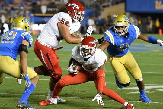 Sep 15, 2018; Pasadena, CA, USA; Fresno State Bulldogs wide receiver KeeSean Johnson (3) tries to elude UCLA Bruins defensive back Nate Meadors (22) and linebacker Keisean Lucier-South (11) during the first quarter at Rose Bowl. Mandatory Credit: Robert Hanashiro-USA TODAY Sports