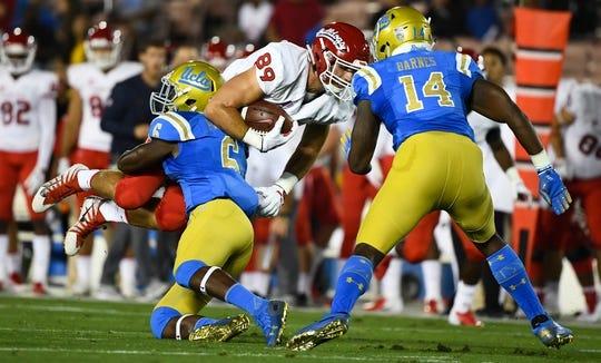 Sep 15, 2018; Pasadena, CA, USA; Fresno State Bulldogs tight end Kyle Riddering (89) tries to run over UCLA Bruins defensive back Adarius Pickett (6) during the first quarter at Rose Bowl. At right is UCLA linebacker Krys Barnes (14). Mandatory Credit: Robert Hanashiro-USA TODAY Sports