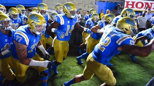 Sep 15, 2018; Pasadena, CA, USA; The UCLA Bruins run onto the field before the start of a game against the Fresno State Bulldogs at the Rose Bowl. Mandatory Credit: Robert Hanashiro-USA TODAY Sports