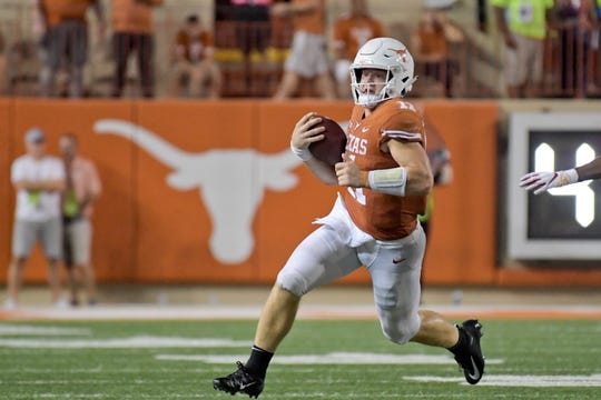 Sep 15, 2018; Austin, TX, USA; Texas Longhorns quarterback Sam Ehlinger (11) rushes against the Southern California Trojans during the second half at Darrell K Royal-Texas Memorial Stadium. Mandatory Credit: Kirby Lee-USA TODAY Sports