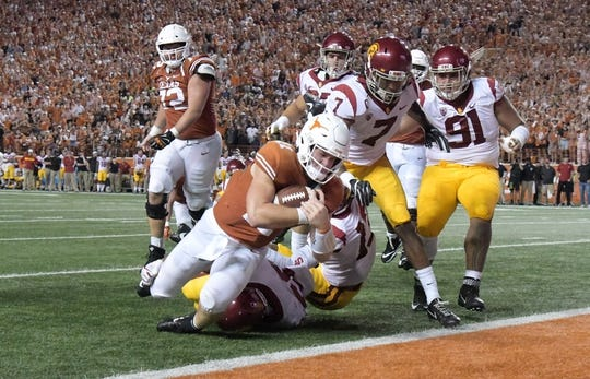 Sep 15, 2018; Austin, TX, USA; Texas Longhorns quarterback Sam Ehlinger (11) scores on a 4-yard touchdown run in the third quarter against the Southern California Trojans at Darrell K Royal-Texas Memorial Stadium. Texas defeated USC 37-14. Mandatory Credit: Kirby Lee-USA TODAY Sports