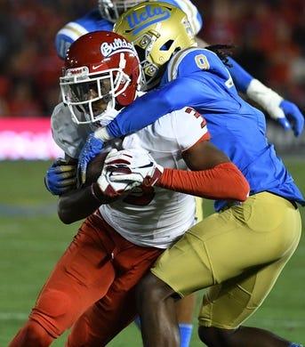 Sep 15, 2018; Pasadena, CA, USA; Fresno State Bulldogs wide receiver KeeSean Johnson (3) tries to break free from UCLA Bruins defensive back Elijah Gates (9) during the third quarter at Rose Bowl. Mandatory Credit: Robert Hanashiro-USA TODAY Sports