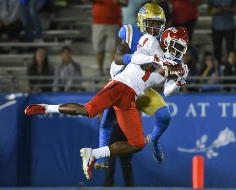 Sep 15, 2018; Pasadena, CA, USA; Fresno State Bulldogs wide receiver Jamire Jordan (1) makes a leaping catch on front of UCLA Bruins defensive back Darnay Holmes (1) in the third quarter at Rose Bowl. Mandatory Credit: Robert Hanashiro-USA TODAY Sports