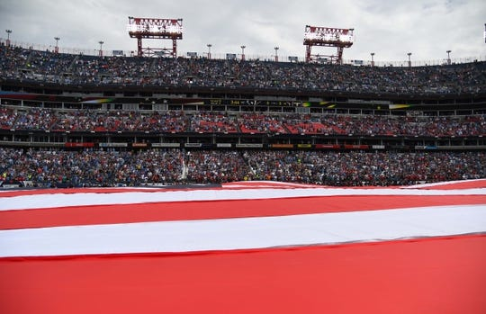 Sep 16, 2018; Nashville, TN, USA; General view during the national anthem with a flag on the field before the game between the Tennessee Titans and Houston Texans at Nissan Stadium. Mandatory Credit: Christopher Hanewinckel-USA TODAY Sports