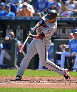Sep 16, 2018; Kansas City, MO, USA; Minnesota Twins shortstop Jorge Polanco (11) hits an RBI single during the second inning against the Kansas City Royals at Kauffman Stadium. Mandatory Credit: Peter G. Aiken