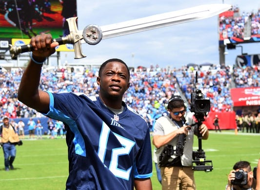Sep 16, 2018; Nashville, TN, USA; Waffle House hero James Shaw Jr. waives the 12th man sword before the Tennessee Titans game against the Houston Texans at Nissan Stadium. Shaw attacked a gunman who was shooting in a Nashville area Waffle House in April. Mandatory Credit: Christopher Hanewinckel-USA TODAY Sports