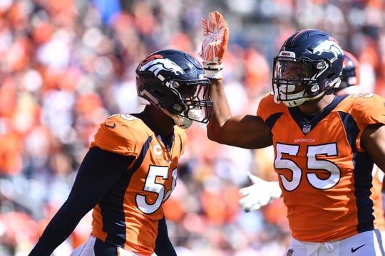 Sep 16, 2018; Denver, CO, USA; Denver Broncos linebacker Von Miller (58) and linebacker Bradley Chubb (55) celebrate a stop in the first quarter against the Oakland Raiders at Broncos Stadium at Mile High. Mandatory Credit: Ron Chenoy-USA TODAY Sports