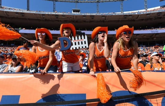 Sep 16, 2018; Denver, CO, USA; Denver Broncos fans cheer in the first quarter against the Oakland Raiders at Broncos Stadium at Mile High. Mandatory Credit: Ron Chenoy-USA TODAY Sports
