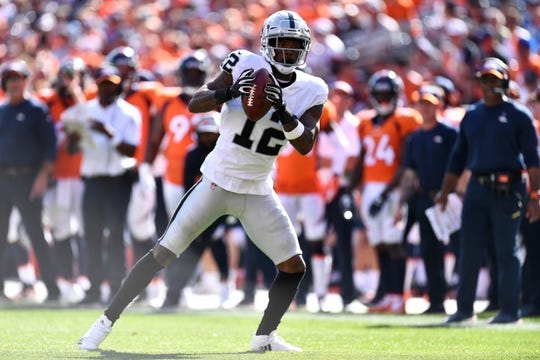 Sep 16, 2018; Denver, CO, USA; Oakland Raiders wide receiver Martavis Bryant (12) pulls in a reception in the second quarter against the Denver Broncos at Broncos Stadium at Mile High. Mandatory Credit: Ron Chenoy-USA TODAY Sports