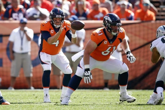 Sep 16, 2018; Denver, CO, USA; Denver Broncos quarterback Case Keenum (4) takes a snap from center Matt Paradis (61) in the first quarter against the Oakland Raiders at Broncos Stadium at Mile High. Mandatory Credit: Isaiah J. Downing-USA TODAY Sports