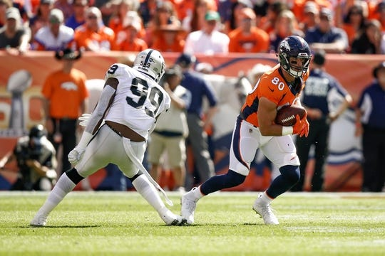 Sep 16, 2018; Denver, CO, USA; Oakland Raiders defensive end Arden Key (99) defends as Denver Broncos tight end Jake Butt (80) runs the ball in the first quarter at Broncos Stadium at Mile High. Mandatory Credit: Isaiah J. Downing-USA TODAY Sports