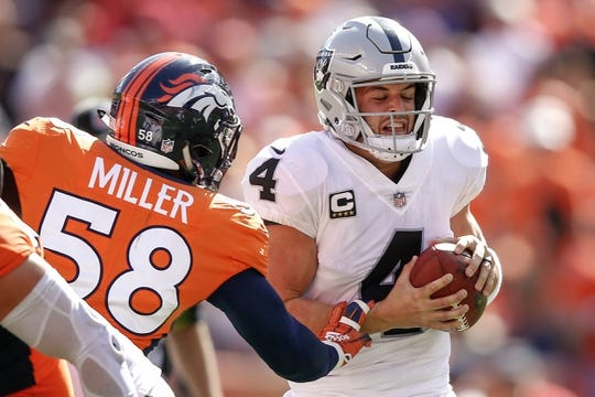 Sep 16, 2018; Denver, CO, USA; Denver Broncos outside linebacker Von Miller (58) pressures Oakland Raiders quarterback Derek Carr (4) in the second quarter at Broncos Stadium at Mile High. Mandatory Credit: Isaiah J. Downing-USA TODAY Sports
