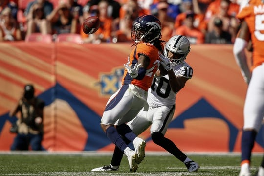 Sep 16, 2018; Denver, CO, USA; Denver Broncos cornerback Bradley Roby (29) breaks up a pass intended for Oakland Raiders wide receiver Seth Roberts (10) in the second quarter at Broncos Stadium at Mile High. Mandatory Credit: Isaiah J. Downing-USA TODAY Sports